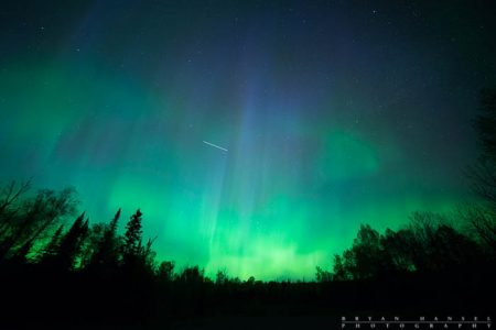 the ISS (International Space Station) flies through the northern lights.