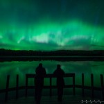 two people watching the northern lights over Mink Lake