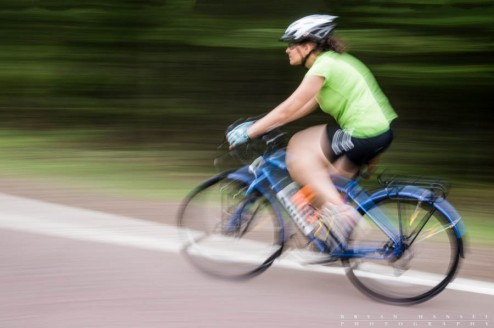 A bike rider speeds by