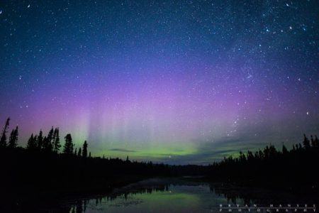 Pink and green northern lights in northern Minnesota