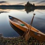 a wooden canoe on a lake near the BWCA