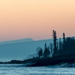 sunset over the sawtooth mountains on lake superior