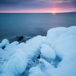a sun pillar lights up the sky above Lake Superior