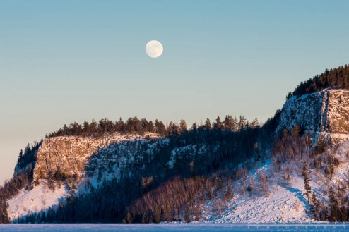 The Wolf Moon rises over the cliffs on Clearwater Lake near the BWCA, Minnesota.