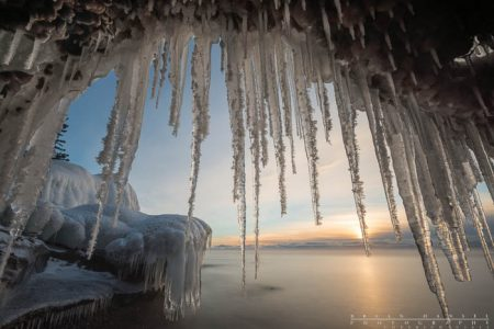 An ice cave formed by frozen beach gravel that was erroded by the waves at Cascade River State Park, Minnesota.