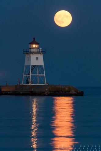 grand marais lighthouse and full moon