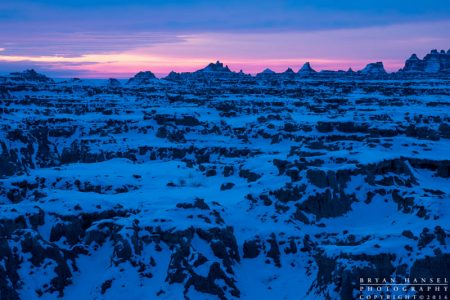 snow covered formations under the pink sunrise