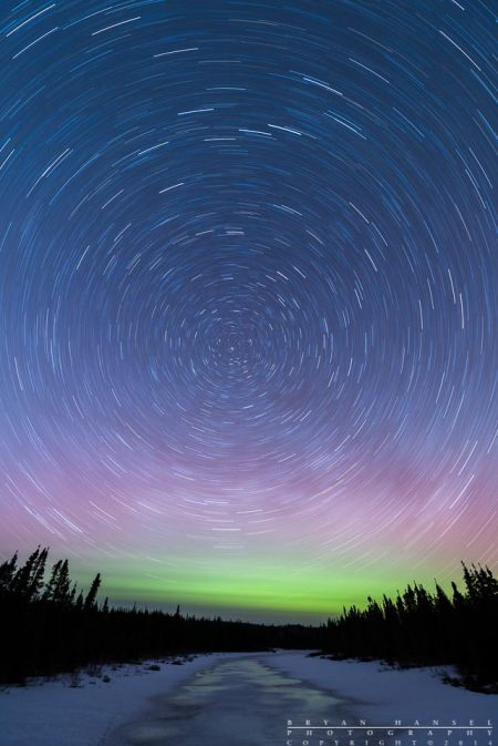 star trails and northern lights above the Cascade River