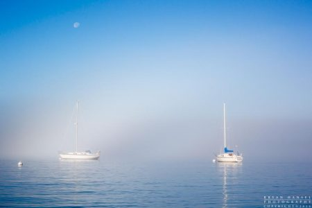 fogbow and waning moon over Grand Marais and Lake Superior