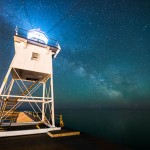 Grand Marais' lighthouse stands strong under the Milky Way while watching for ships on Lake Superior.