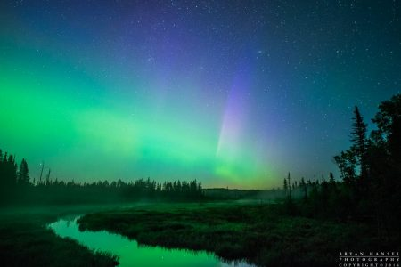 The northern lights glow over Mud Creek in Cook County, Minnesota.