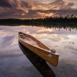 wood canoe at sunset