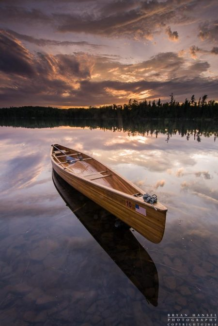 wood canoe at sunset