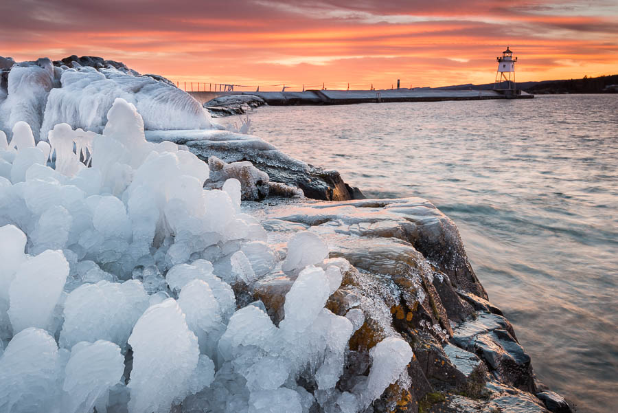 grand marais lighthouse covered in ice