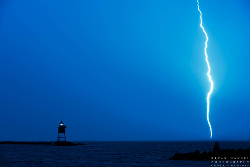 lightning strike behind the Grand Marais lighthouse