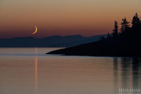 crescent moon sets over Lutsen Resort