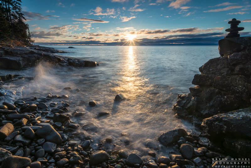 The sun rises over Lake Superior at Cascade River State Park, Cook County, Minnesota.