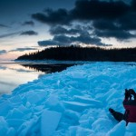 Travis Novitsky sits in ice plates