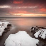 The sunrise over Lake Superior from a wintery Artist's Point. Cook County, Grand Marais, Minnesota.