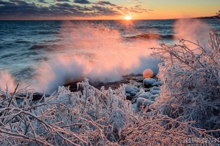 sunset and waves and frozen shoreline