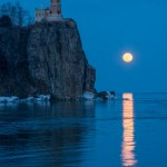 the full moon rises over split rock lighthouse