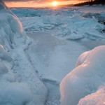 winter ice piles on Lake Superior at sunset