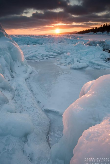 winter ice piles on Lake Superior at sunset