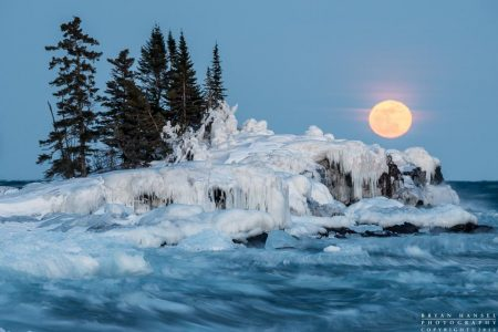 Full Crow Moon rises above Lake Superior