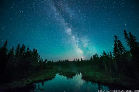 The Milky Way glows over Mud Creek in northern Cook County, Minnesota.