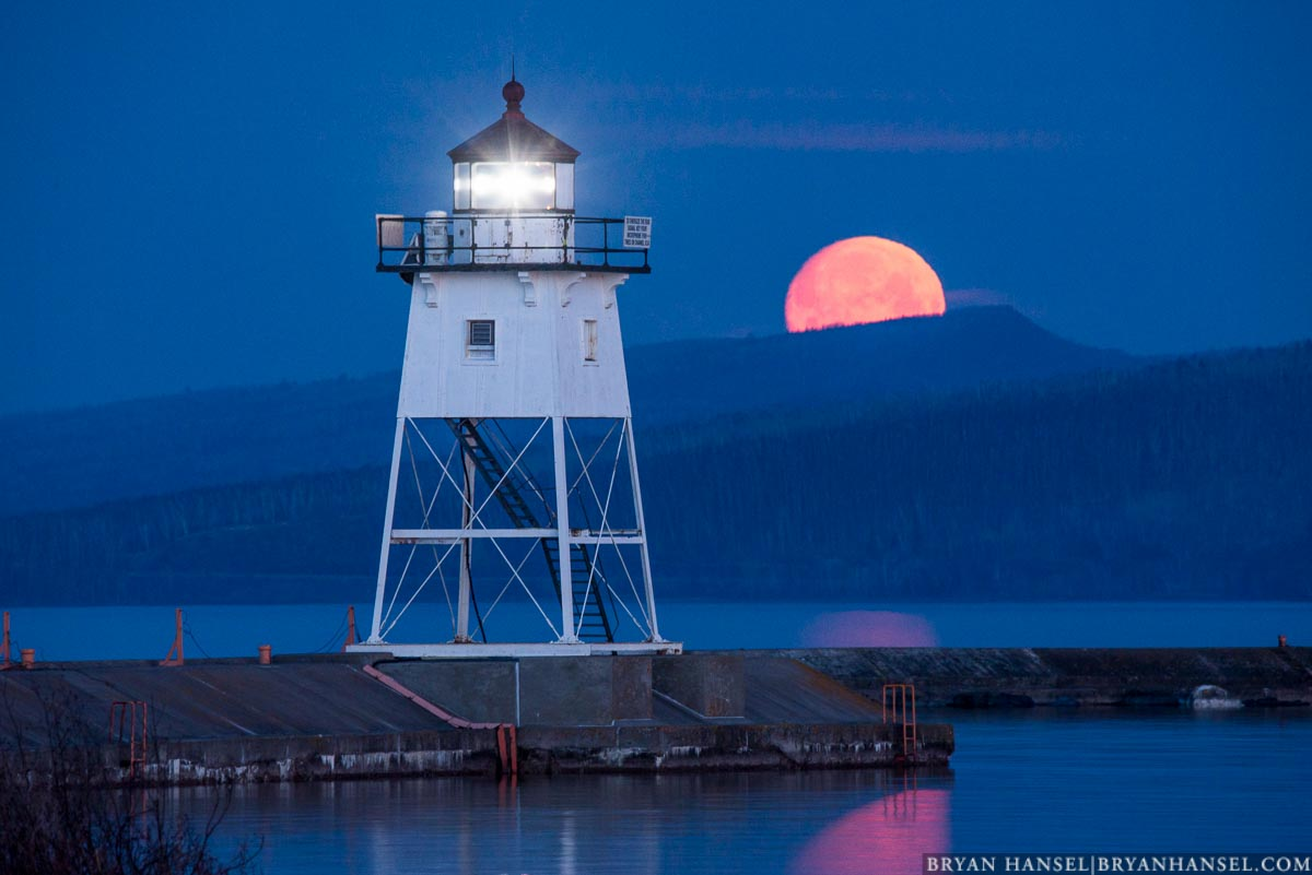 moon behind the lighthouse