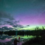 paddler under the northern lights