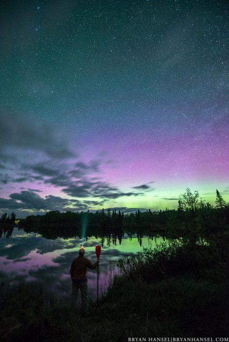 paddler under the northern lights