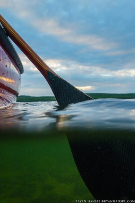 canoe and underwater paddle at sunset