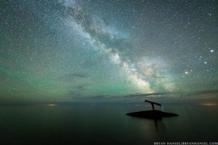 portaging a canoe under the Milky Way