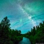 milky way and northern lights over the CAscade River