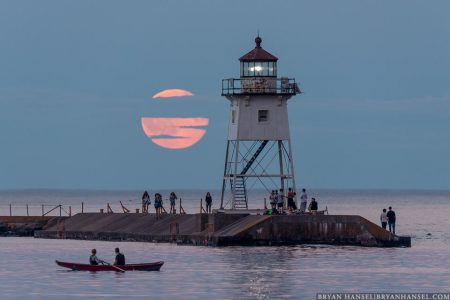 blue full moon over grand marais lighthouse
