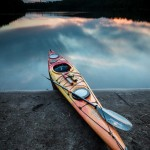 kayak at sunset on mink lake, minnesota