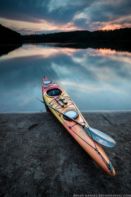 kayak at sunset on mink lake, minnesota
