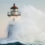 Waves wash against the Grand Marais, MN Lighthouse.