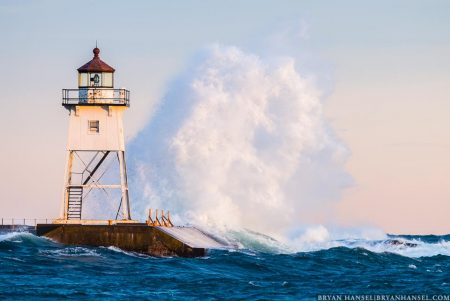 Waves wash against the Grand Marais, MN Lighthouse.