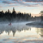 paddling a Northstar canoe in the morning fog