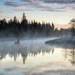 paddling a Northstar canoe in the morning fog