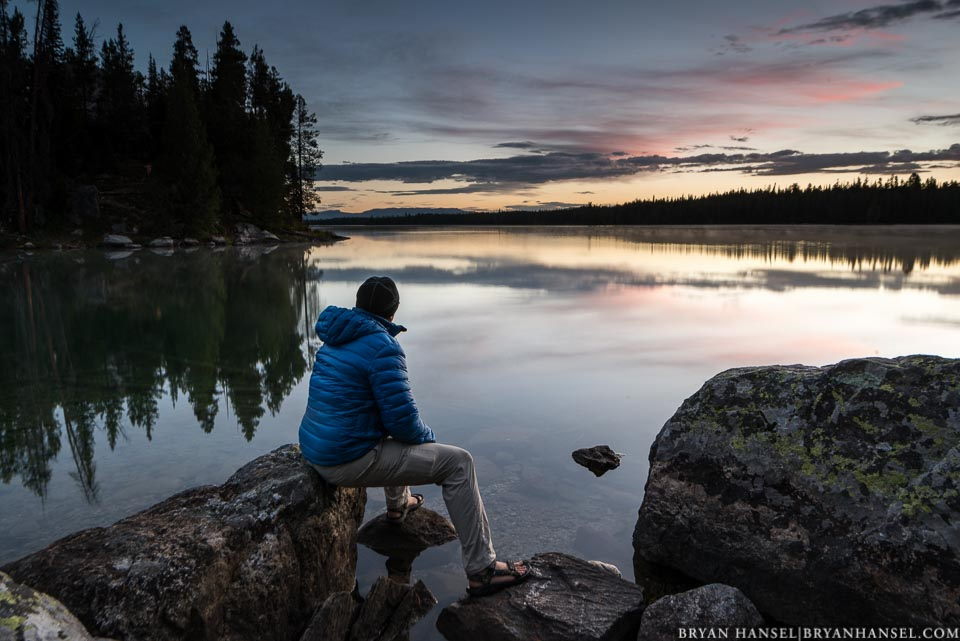 person watching sunrise in the Tetons