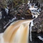cascade river in winter flood