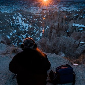 photographer at sunset in the badlands