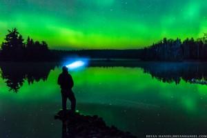 blue headlamp under northern lights