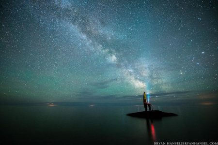 canoe and paddler under the Milky Way