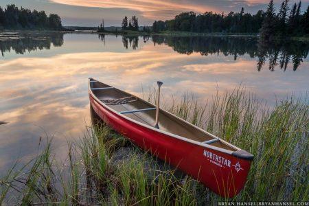 canoe on devil track lake at sunset