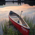 canoe at sunset on devil track lake