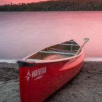 a canoe under a red sky on Mink Lake